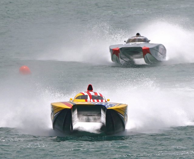 WHM Motorsports (L), piloted by William Mauff and Jay Muller, maintain a lead over Team Amsoil, with Bob Teague and Paul Whitier at the controls, during the Superboat class at the Marathon Super Boat Grand Prix in Marathon, Florida July 5, 2015. (Photo by Bob Care/Reuters/Florida Keys News Bureau)