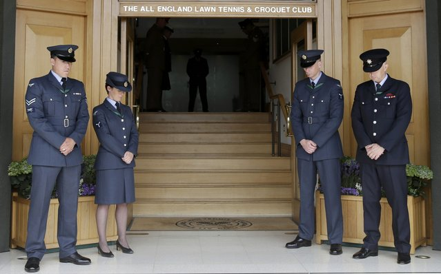 Members of the armed forces observe a minutes silence in memory of the 7/7 bombings in London at the Wimbledon Tennis Championships in London, July 7, 2015. (Photo by Henry Browne/Reuters)