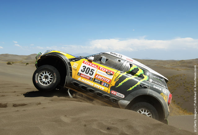 Nani Roma of Spain drives his Mini over a sand dune on stage two of the 2012 Dakar Rally