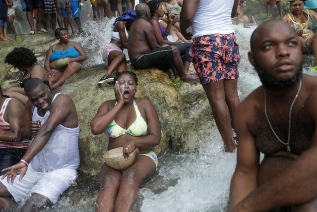 Haitians bathe during the celebration of the annual pilgrimage to the waterfall in Saut D'Eau, Haiti, July 14, 2019. (Photo by Andres Martinez Casares/Reuters)