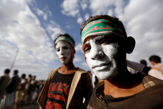 "Boys with their faces coloured with Yemen's national flag, attend a demonstration against the U.S. intervention in Yemen, in the country's capital Sanaa, May 13, 2016. The headband reads, ""We are steadfast against the aggression"". (Photo by Khaled Abdullah/Reuters)"