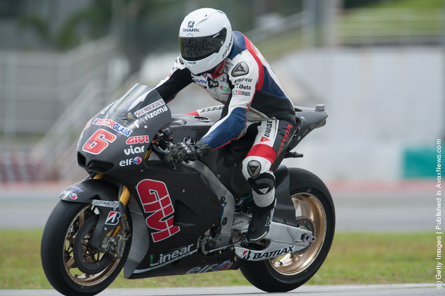 Stefan Bradl of Germany and LCR Honda MotoGP heads down a straight during the first day of MotoGP testing at Sepang Circuit