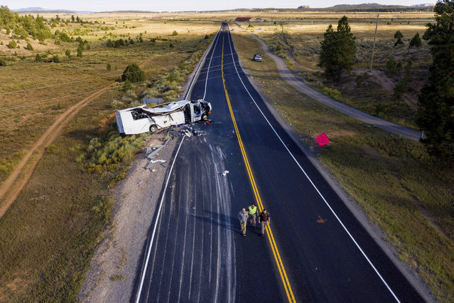 The remains of a bus that crashed while carrying Chinese-speaking tourists lie along State Route 12 near Bryce Canyon National Park, Friday, September 20, 2019, in Utah, as authorities continue to investigate. (Photo by Spenser Heaps/The Deseret News via AP Photo)