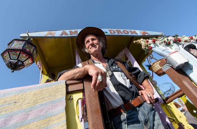 A gypsy stands in front of his folklore wagon on May 24, 2016 in Staintes Maries de la Mere near Arles, France. (Photo by Thomas Lohnes/Getty Images)