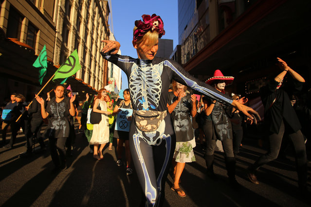 Protesters participate in a Halloween-themed Extinction Rebellion rally in Sydney, Australia on October 29, 2019. (Photo by Steven Saphore/AAP)