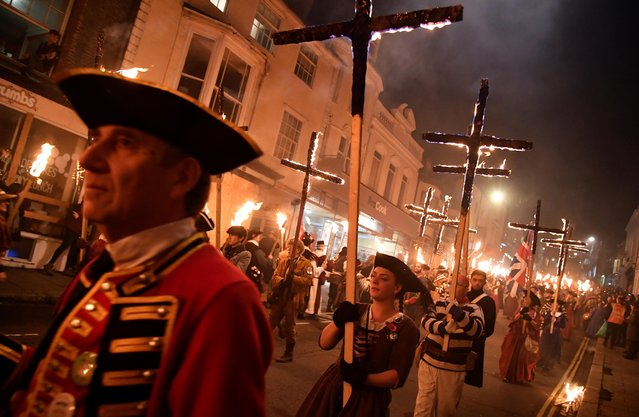 Participants parade through the town during the annual Bonfire Night festivities in Lewes, Britain, November 5, 2019. (Photo by Toby Melville/Reuters)