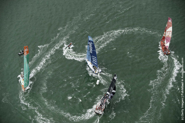 The fleet of Volvo Open 70's round one of the marks in Auckland Harbour, at the start of leg 5 from Auckland, New Zealand to Itajai, Brazil, during the Volvo Ocean Race 2011-12