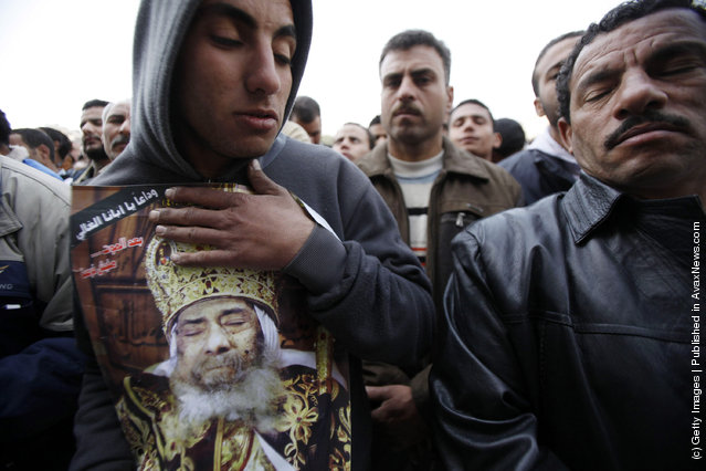 Egyptian Christians mourn during the funeral of Pope Shenouda III, the head of Egypt's Coptic Orthodox Church, at the Abassiya Cathedral at the funeral of Pope Shenouda III, the head of Egypt's Coptic Orthodox Church, near the Abassiya Cathedral