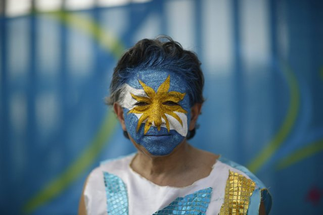 A fan with face paint stands outside Maracana stadium where the first 2014 World Cup match for Argentina's national soccer team will take place in Rio de Janeiro, Brazil, on Sunday, June 15, 2014. The Maracana is the spiritual home of Brazilian soccer, where record attendance was attained in 1950 when Brazil lost to Uruguay in the Cup finals. (Photo by Dado Galdieri/Bloomberg)