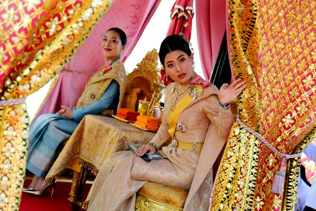 This handout picture taken and released by Thai Royal Household Bureau on December 12, 2019 shows Thailand's Princess Bajrakitiyabha (L) and Princess Sirivannavari sit in their barge during the Royal Barge procession in Bangkok. The Royal barge procession is the final event of the coronation of Thailand's King Maha Vajiralongkorn. (Photo by Thai Royal Household Bureau via AFP Photo/Handout)