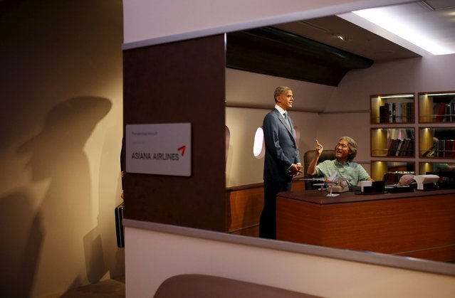 A man poses for photographs next to the wax figure of U.S. President Barack Obama at Grevin Wax Museum in central Seoul, South Korea, July 30, 2015. (Photo by Kim Hong-Ji/Reuters)