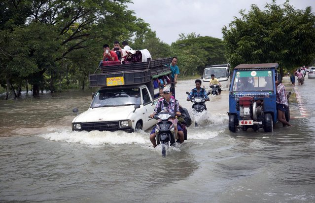 Vehicles make their way through a flooded road in Bago, 80 kilometers (50 miles) northeast of Yangon, Myanmar, Saturday, August 1, 2015. (Photo by Khin Maung Win/AP Photo)