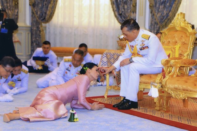 In this photo released by Bureau of the Royal Household, Thailand's King Maha Vajiralongkorn Bodindradebayavarangkun, right, presents a gift to Queen Suthida Vajiralongkorn Na Ayudhya at Ampornsan Throne Hall in Bangkok, Thailand, Wednesday, May 1, 2019.Thailand's King Maha Vajiralongkorn, who will have his official coronation on Saturday, has appointed his consort as the country's queen. An announcement Wednesday in the Royal Gazette said Suthida Vajiralongkorn Na Ayudhya is legally married to the 66-year-old king, and is now Queen Suthida. (Photo by Bureau of the Royal Household via AFP Photo)