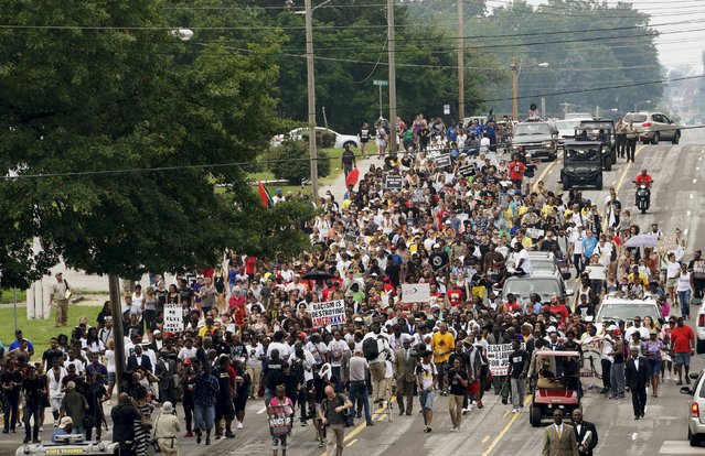 A protest march led by Michael Brown Sr. walks the streets to mark the one year anniversary of the killing of son Michael Brown Jr. in Ferguson, Missouri, August 9, 2015. (Photo by Rick Wilking/Reuters)