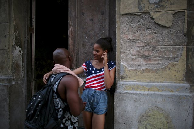 Dancers Karla Enriques, 16 (R), and Yudi Gonzalez, 20, chat in downtown Havana, August 6, 2015. (Photo by Alexandre Meneghini/Reuters)