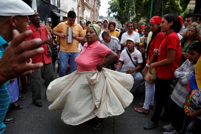 "People dance and play music during ""Dia de San Juan"" (St. John's Day) religious festival in Caracas, Venezuela, June 24, 2016. (Photo by Marco Bello/Reuters)"