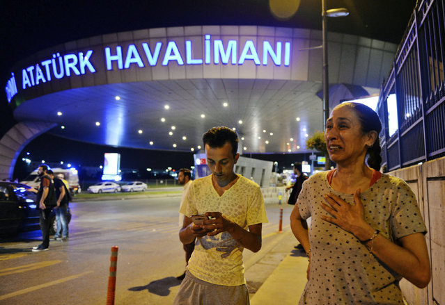 People gather on the entrance to Istanbul's Ataturk airport, early Wednesday, June 29, 2016. (Photo by Emrah Gurel/AP Photo)