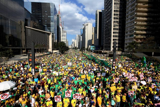 Demonstrators attend a protest against Brazil's President Dilma Rousseff, part of nationwide protests calling for her impeachment, at Paulista Avenue in Sao Paulo's financial centre, Brazil, August 16, 2015. (Photo by Paulo Whitaker/Reuters)