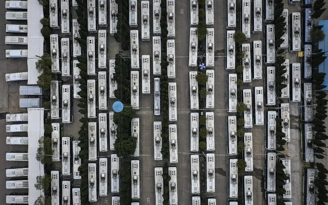 Out of service buses are parked on February 13, 2020 in Wuhan, Hubei province, China. Flights, trains and public transport including buses, subway and ferry services have been closed for 22 days. The number of those who have died from the Wuhan coronavirus, known as 2019-nCoV, in China climbed to 1368. (Photo by Stringer/Getty Images)