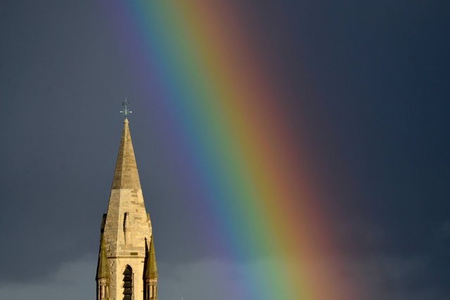 A rainbow above St Peter's church in Nottingham after a sudden downpour, on August 29, 2012. (Photo by Lewis Stickley/PA Wire)