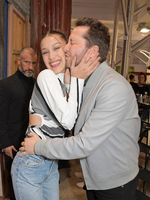 Derek Blasberg (L) attends as Bella Hadid signs copies of LOVE Magazine during London Fashion Week February 2020 at Dover Street Market on February 17, 2020 in London, England. (Photo by David M. Benett/Dave Benett/Getty Images)
