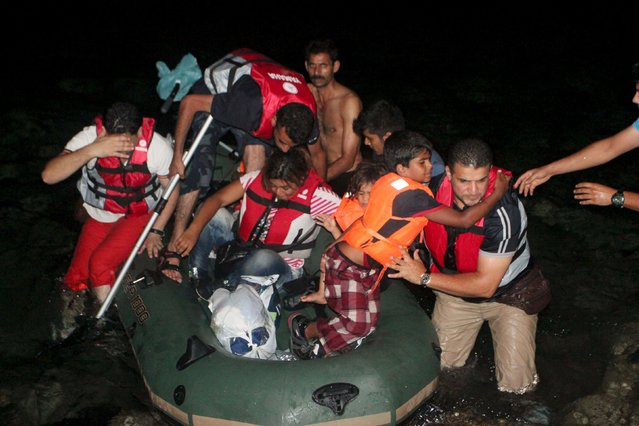Migrants disembark from a dinghy after their failed attempt to sail off for the Greek island of Kos from the Turkish coastal town of Bodrum, Turkey, early August 20, 2015. (Photo by Kenan Gurbuz/Reuters)