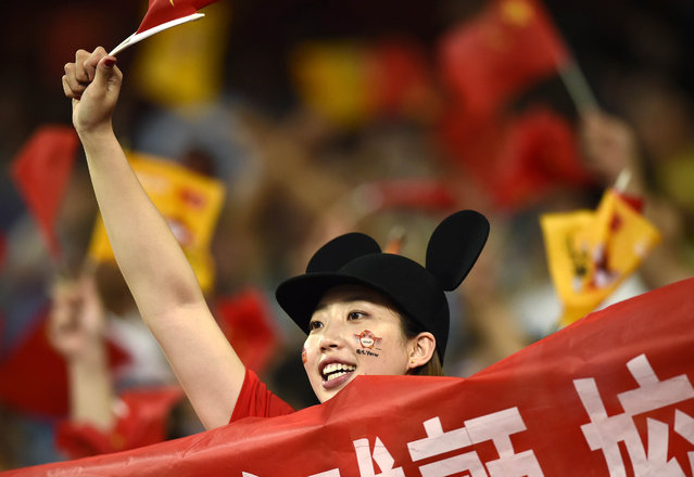 A China fan cheers on her team at the 15th IAAF World Championships at the National Stadium in Beijing, China August 22, 2015. (Photo by Dylan Martinez/Reuters)