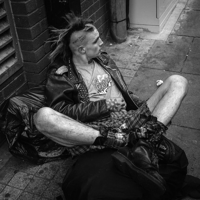 Punk sits on the street of Blackpool. (Photo by Christopher Furlong/Getty Images)