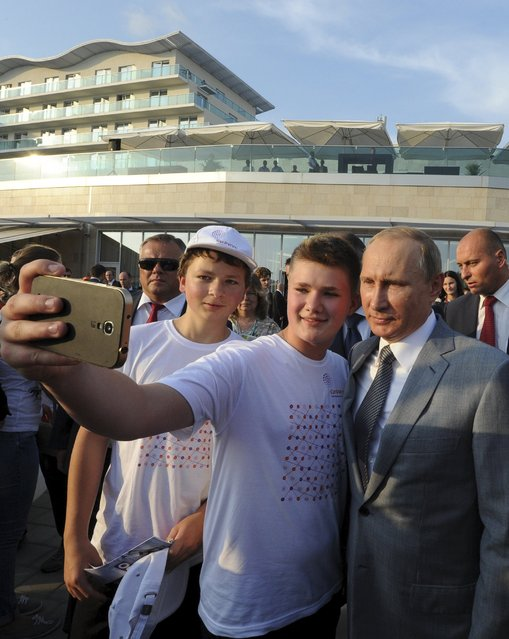 Russian President Vladimir Putin (R) poses for a selfie with students at the Sirius educational centre for gifted children in Sochi, Russia, September 1, 2015. (Photo by Mikhail Klimentyev/Reuters/RIA Novosti/Kremlin)