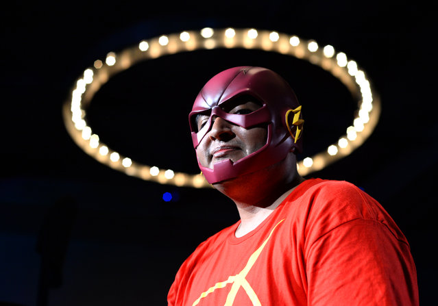 """Fan dressed as the Flash stands in line to ask a question during the Q and A at """"The Flash"""" panel on day 3 of Comic-Con International on Saturday, July 23, 2016, in San Diego. (Photo by Al Powers/Invision/AP Photo)"""