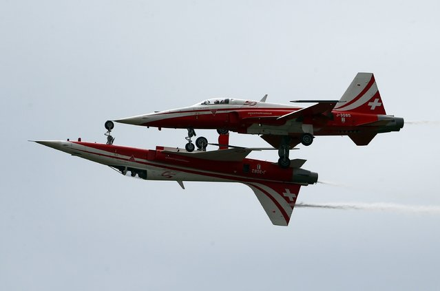 Northrop F-5E Tigers aircrafts of the Patrouille Suisse perform during the Air14 airshow at the airport in Payerne August 31, 2014. (Photo by Denis Balibouse/Reuters)