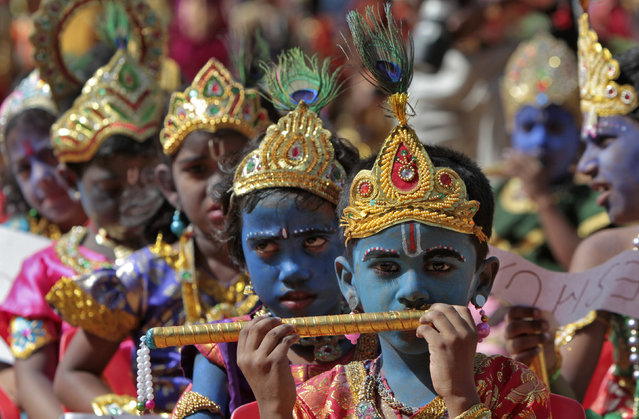 "School children dressed as Hindu Lord Krishna take part in a function held ahead of ""Janamashtmi"" celebrations in Chennai, August 8, 2012. (Photo by Reuters/Babu)"