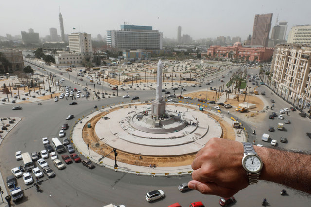 A watch showing the time at noon, is displayed for a photo in front of Tahrir Square during the coronavirus disease (COVID-19) outbreak, in Cairo, Egypt, March 31, 2020. (Photo by Mohamed Abd El Ghany/Reuters)