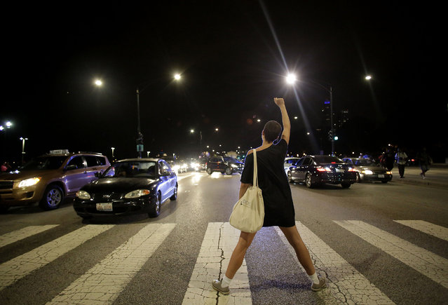 A demonstrator raises her fist as she blocks Lake Shore Drive during a protest for the fatal police shooting of Paul O'Neal August 7, 2016 in Chicago, Illinois. O'Neal, an unarmed 18-year-old man  was shot and fatally wounded July 28, when Chicago Police officers tried to arrest him for allegedly stealing a Jaguar car from the suburbs. The Chicago Police department released videos of the shooting to the public and media, which was captured by body cameras and dashboard cameras. (Photo by Joshua Lott/Getty Images)