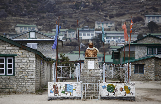 A statue of Sir Edmund Hillary, one of the first climbers to reach the summit of Mount Everest and the founder of Khumjung High School, is seen in the school grounds in Khumjung, approximately 12139 feet above sea level in Solukhumbu District May 8, 2014. (Photo by Navesh Chitrakar/Reuters)