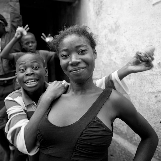 """Girl And Boy Smiling In Caconda, Angola. They smile, but they have a really hard life, in a remote area, after 30 years of civil war""... (Eric Lafforgue)"