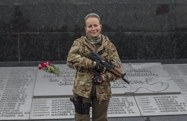 A woman fighting on the side of pro-Russian rebels poses with her rifle in Donetsk, eastern Ukraine, September 8, 2014. (Photo by Marko Djurica/Reuters)