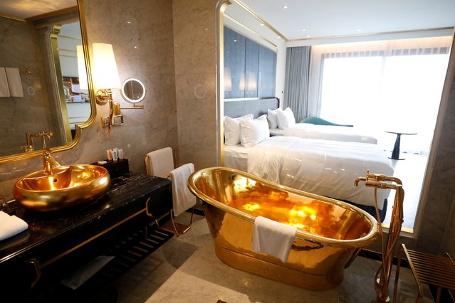 A gold plated bathtub and a gold plated bathroom sink are seen in the newly-inaugurated Dolce Hanoi Golden Lake luxury hotel, after the government eased a nationwide lockdown following the global outbreak of the coronavirus disease (COVID-19), in Hanoi, Vietnam on July 2, 2020. (Photo by Reuters/Kham)