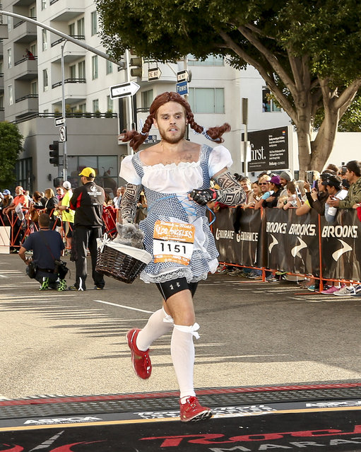 General view of a runner preparing to cross the finish line at the Rock 'n' Roll Los Angeles Halloween Half-Marathon and 5K benefitting the ASPCA on October 26, 2014 in Los Angeles, California. (Photo by Rich Polk/Getty Images for CGI)