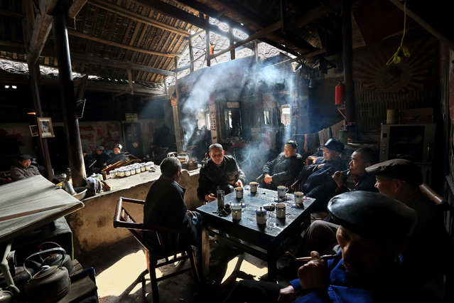 """""""The joy of tea and companion"""". I travelled to Chengdu, China last spring and encountered this group of elderly men enjoying their tea time in a traditional tea house. Photo location: China. (Photo and caption by Seng Huat Phua/National Geographic Photo Contest)"""