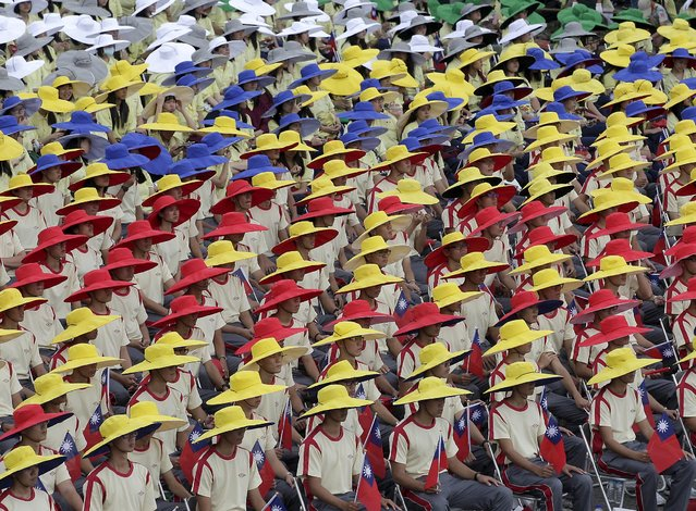 Participants in coordinated colours hold national flags during Taiwan's National Day celebrations in front of the presidential office in Taipei, Taiwan, October 10, 2015. (Photo by Pichi Chuang/Reuters)