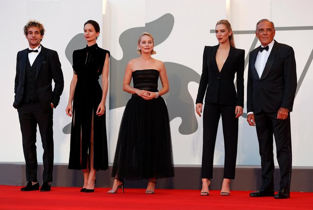 """(L-R) Christopher Abbott, Katherine Waterston, Director Mona Fastvold, Vanessa Kirby and Venice Film Festival director Alberto Barbera walk the red carpet ahead of the movie """"The World To Come"""" at the 77th Venice Film Festival on September 06, 2020 in Venice, Italy. (Photo by Guglielmo Mangiapane/Reuters)"""