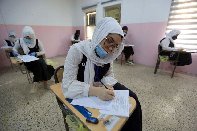 Iraqi students, wearing protective masks, maintain social distancing while taking their final exams amid coronavirus (COVID-19) measures in Baghdad, Iraq on September 01, 2020. (Photo by Murtadha Al-Sudani/Anadolu Agency via Getty Images)