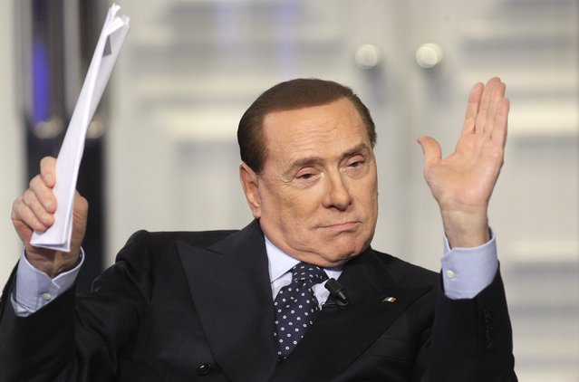 "Italy's former Prime Minister Silvio Berlusconi gestures as he appears as a guest on the RAI television show ""Porta a Porta"" (""Door to Door"") in Rome February 20, 2013. (Photo by Remo Casilli/Reuters)"