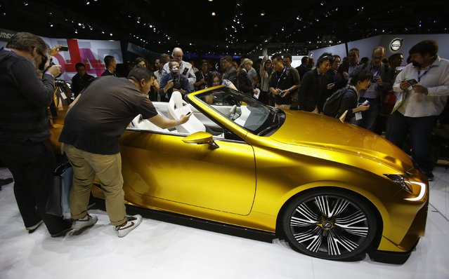 People look at a Lexus LF-C2 concept vehicle on display during the model's world debut at the Los Angeles Auto Show in Los Angeles, California November 19, 2014. (Photo by Mario Anzuoni/Reuters)
