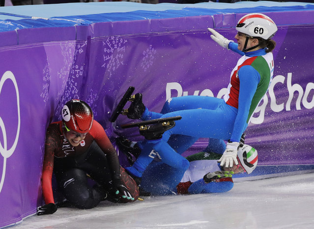 Italy's Lucia Peretti and Cecilia Maffei collide with Canada's Valerie Maltais during their women's 3000 meters short track speedskating relay A final in the Gangneung Ice Arena at the 2018 Winter Olympics in Gangneung, South Korea, Tuesday, February 20, 2018. (Photo by David J. Phillip/AP Photo)