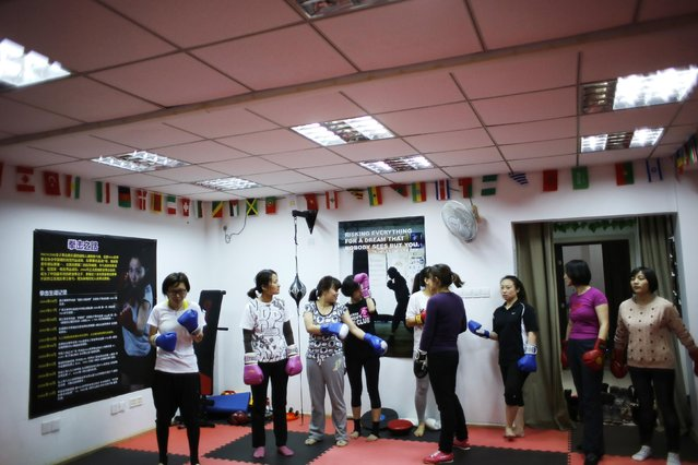 Women attend a boxing class at Princess Women's Boxing Club in Shanghai December 8, 2014. (Photo by Carlos Barria/Reuters)