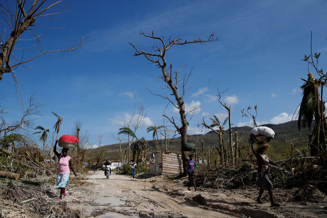 People walk down a street after Hurricane Matthew hit Jeremie, Haiti, October 7, 2016. (Photo by Carlos Garcia Rawlins/Reuters)