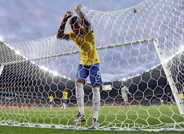 In this July 8, 2014 file photo, Brazil's Fernandinho reacts after Germany's Toni Kroosduring scored a third goal during their World Cup semifinal soccer match in Belo Horizonte, Brazil. (Photo by Natacha Pisarenko/AP Photo)