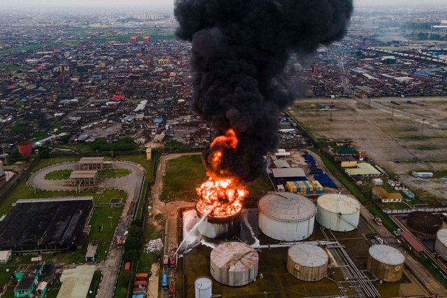An aerial view shows an oil tanker on fire at the OVH Energy Marketing (a licensee of the Oando retail brand and ASPM Limited) in Apapa, Lagos, on November 5, 2020. The cause of the fire is still unknown at this point but the fire service is on the ground to control the fire outbreak. (Photo by Benson Ibeabuchi/AFP Photo)